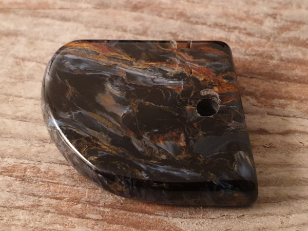 pietersite with drilling
